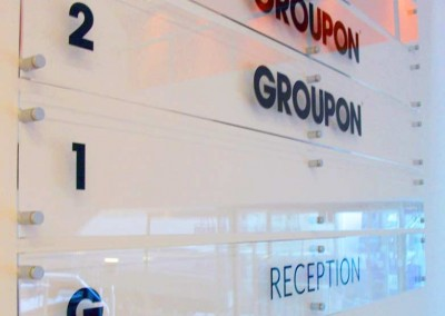 Business signage made from acrylic with vinyl graphics to rear and stand off fixings
