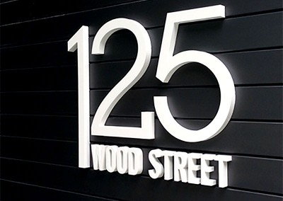 3D letters cut from corian for high end property by Aspect Signs & Engraving. Sign Makers London