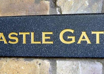 Simulated granite name plates with gold paint infill